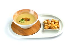 Mushroom cream soup and crackers on an isolated white background stock photo
