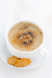 Mushroom cream soup with croutons on white wooden table Stock Photo