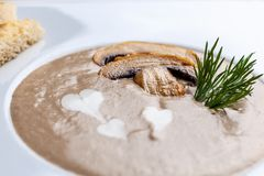 Mushroom cream soup with heart on top royalty free stock photos