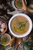 Mushroom cream soup on the rustic background top view. Vertical Royalty Free Stock Image