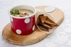Mushroom cream soup with sausages and croutons royalty free stock photos