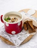 Mushroom cream soup with sausages and croutons stock photography