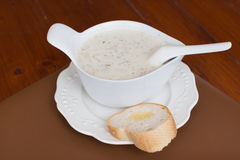 Mushroom cream soup setting on wood table Stock Photos