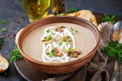 Mushroom cream soup. Vegan food. Dietary menu. Black background stock photos