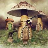 Mushroom fairy houses on a meadow. Three colorful mushroom fairy houses on a green meadow with flowers stock illustration