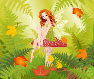 Mushroom Fairy. Illustration of cute fairy sits on fly agaric Royalty Free Stock Image