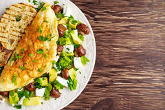 Mushroom, Feta Cheese egg Omelette witch Avocado, vegetables, lettuce, herbs and grilled bread. Royalty Free Stock Photography