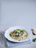 Mushroom and foie gras risotto arborio rice with basil. Healthy gourmet meal, dinner Royalty Free Stock Image