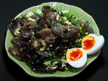 Mushroom fried with Egg and onion and vegetable. Auricularia auricula-judae, Jew's ear, wood ear, jelly ear, mushroom fried with Egg and onion and vegetable Stock Image