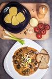 Mushroom goulash served with bread, potato dumpling and onion Royalty Free Stock Photos
