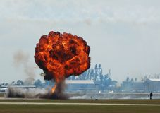 Mushroom ground explosion. Large explosion at industrial facility with fire and black smoke Royalty Free Stock Images