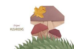 Mushroom group origami isolated on a white royalty free stock photo