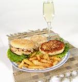 Mushroom hamburger. Chicken hamburger with mushroom cream sauce and French fries focus con meat and bun stock photos