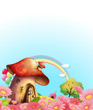 A mushroom house above the hill with a garden Stock Photos