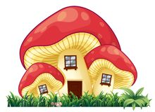 Mushroom house on the grass. Illustration Stock Photos