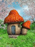 Mushroom house in the meadow Stock Photo