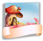 A mushroom house with a signage Royalty Free Stock Image