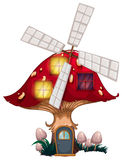 A mushroom house with a windmill Royalty Free Stock Images