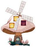 A mushroom house with a windmill Stock Photos