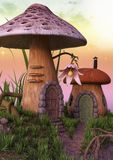 Fairytale mushroom houses with a flower. Stock Photo