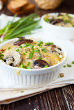 Mushroom julienne in a white bowl Stock Images
