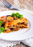 Mushroom lasagna on plate Stock Photos