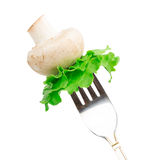 Mushroom and leaves of green salad on a fork Isolated on white b Royalty Free Stock Photography