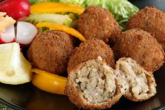 Mushroom and mozarella arancini. Delicious mushroom amd mozarella arancini with fresh salad Stock Image