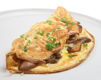 Mushroom Omelet. Freshly cooked omelet filled with cheese and sauteed mushrooms stock photos