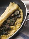 Mushroom Omelette folded in a Omelette Pan. Close up of Mushroom Omelette folded in a Omelette Pan stock photo