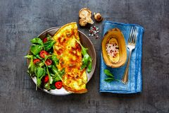 Mushroom omelette and salad royalty free stock photos