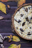 Mushroom onion quiche on a dark wooden background Royalty Free Stock Images