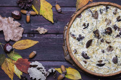 Mushroom onion quiche on a dark wooden background Stock Images