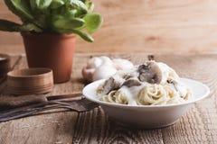 Mushroom pasta with creamy parmesan sauce royalty free stock photo