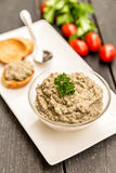 Mushroom pate in a bowl. With crispbread on a plate, served with tomatoes, Vegetarian concept food Stock Images