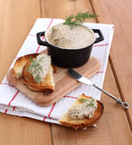 Mushroom pate and bread. On the wooden board Royalty Free Stock Photo