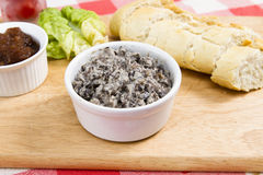 Mushroom pate with French baguette. Mushroom pate with relish lettuce and tomatoes Stock Photo