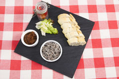 Mushroom pate with French baguette. A slate plate with mushroom pate and baguette Royalty Free Stock Images
