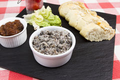 Mushroom pate with French baguette. A slate plate with mushroom pate and baguette Stock Image