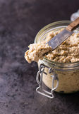 Mushroom pate in a jar over dark background Stock Photography