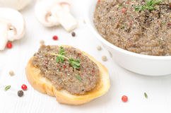 Mushroom pate on toast and bowl of pate Stock Images