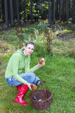 Mushroom picking woman Royalty Free Stock Image
