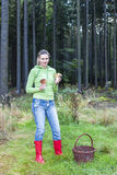 Mushroom picking woman Royalty Free Stock Photos