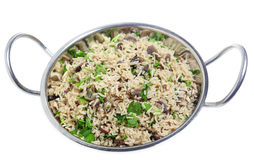 Mushroom pilau in kadai bowl. A mushroom pilau, with basmati rice, in a kadai serving bowl over a white background Royalty Free Stock Photo