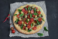 Mushroom pizza with cherry tomatoes and basil Royalty Free Stock Photo