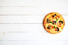 Mushroom pizza on white wooden table with copy space, top view. Ready to eat.  Royalty Free Stock Image