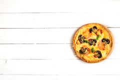 Mushroom pizza on white wooden table with copy space, top view. Ready to eat.  Royalty Free Stock Photography