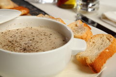 Mushroom porcini soup. Served with bread Stock Photography