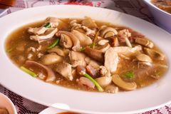 Mushroom , pork and dried squid fried with oyster sauce Royalty Free Stock Photo