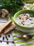 Mushroom puree soup with allspice, parsley, champignons and toasts. On wooden background. Selective focus stock photos
